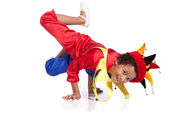 Breakdancing boy dressed in clown costume — Stock Photo