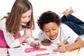 Interracial children drawing together — Stock Photo