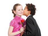 Boy giving a rose to a girl, — Stock Photo