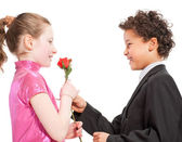 Boy giving a rose to a girl — Stock Photo