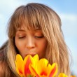 Beautiful spring portrait with tulips — Stock Photo