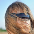 Young blond woman in sunglasses - Stock Photo