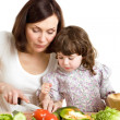 Mother and daughter cooking at the kitchen — Stock Photo