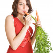 Pregnant woman with fresh carrots — Stock Photo #6044989