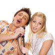 Attractive young couple singing - Stock Photo