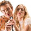Attractive young couple singing — Stock Photo