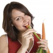 Woman with fresh carrots — Stock Photo #6049613