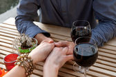 Man and women hands with vine — Stock Photo