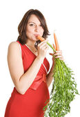 Pregnant woman with fresh carrots — ストック写真