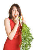 Pregnant woman with fresh carrots — Stock Photo