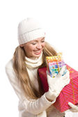 Portrait happy girl with a gift — Stock Photo