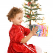 Happy little girl with a Christmas gift — Stock Photo #6050073
