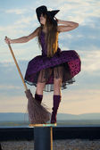 Pretty witch with hat and broom — Stock Photo