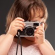Little girl with old camera — Stock Photo #6148913