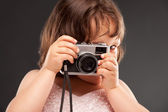 Little girl with a old camera — Stock Photo