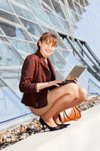Young businesswoman sitting on stairway — Stock Photo