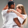 Stock Photo: Young couple dances CaribbeSalsa