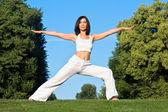 Young woman doing yoga outside — Stock Photo