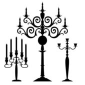 Set of vector candelabra silhouettes — Stock Vector