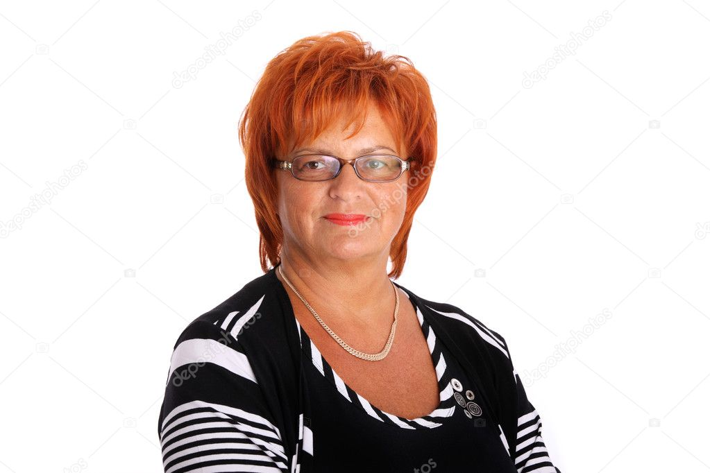 A portrait of an attractive confident woman in her fifties smiling over white background — Stock Photo #5909163