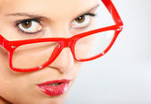 Woman in red glasses — Stock Photo