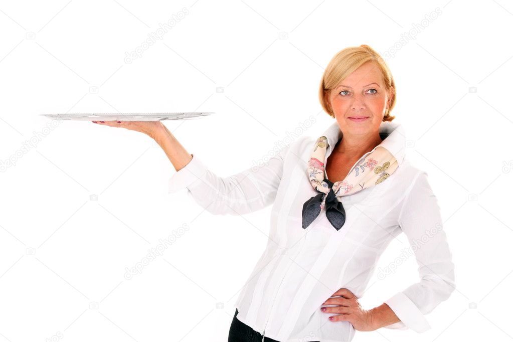 A picture of a pretty mature woman serving your product on a tray against white background — Stock Photo #6252439