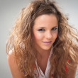 Beautiful fashion young smiling girl with makeup and coiffure — Stok fotoğraf