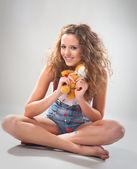 Playful teen girl with teddy — Stock Photo