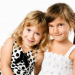 Two little girlfrends isolated on white background — Stock Photo
