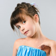 Close-up portrait of adorable girl posing in studio — Stock Photo