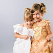 Two cute little prom girls wearing gowns — Stock Photo