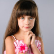 Cute little girl closeup portrait in studio — Stock Photo