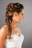 Bridal hairdo with a plate on studio neutral background — Stock Photo