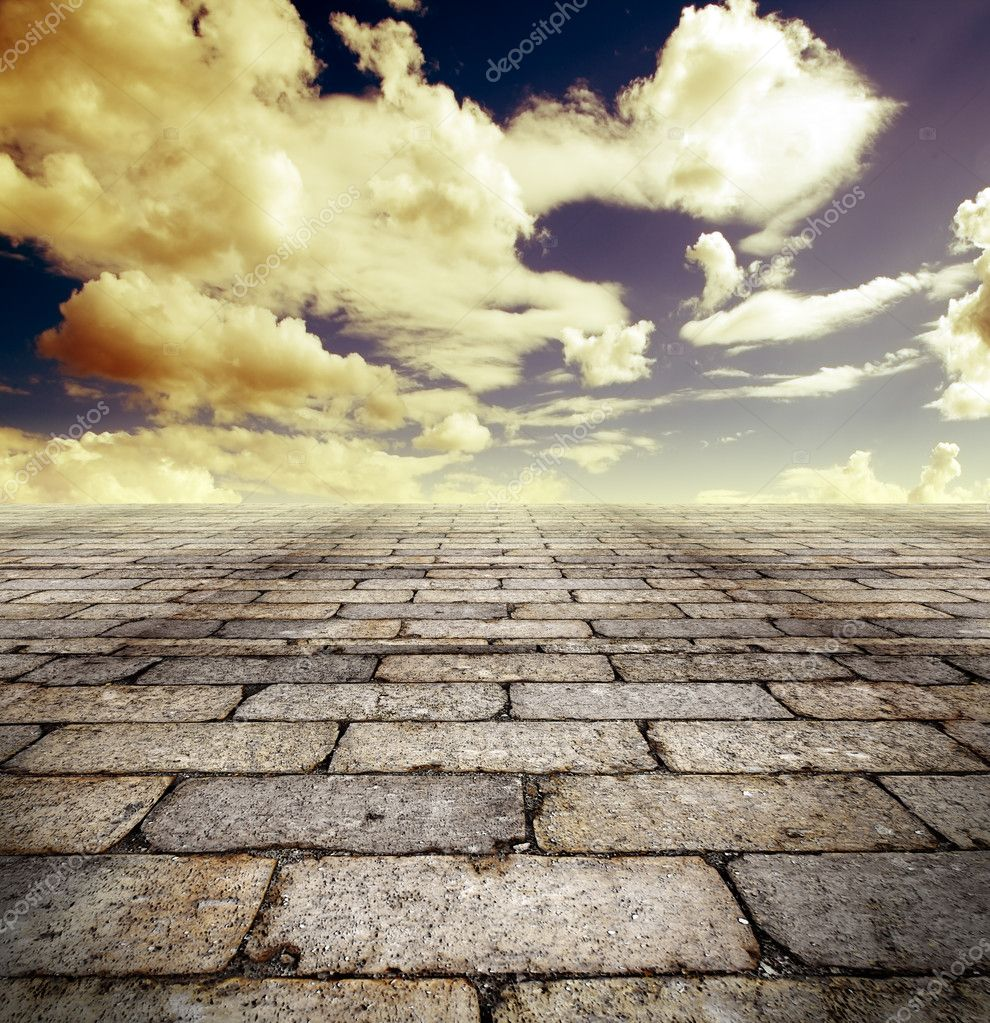 Architectural background with cobbled streets and sky — Stock Photo #6058615