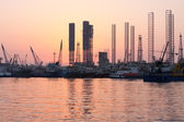 Oil rigs at sunset, Sharjah, Uae — Stock Photo