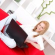 Using laptop at home — Stock Photo