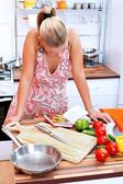 Woman with recipe book — Stock Photo