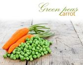 Carrots and green peas — Stock Photo