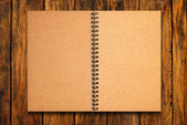 Blank notebook open on wood background — Stock Photo