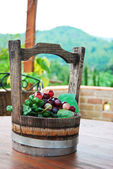 Grapes bunch in wood bucket — Stock Photo
