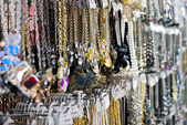 Variety of jewelry in market — Stock Photo