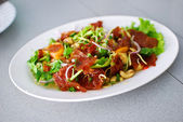 Sliced ​​sheets of dried and crispy pork spicy salad — Stock Photo