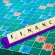 Finance letter on the board game sheet — Stock Photo