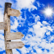 Wooden signboard on blue sky — Stock Photo