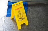 Caution wet floor warning sign — Stock Photo