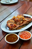 Grilled chicken with spicy sauce — Stock Photo