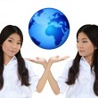 Business woman and the blue earth — Stock Photo