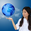 Business woman and the blue earth — Stock Photo #6592978