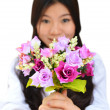 Woman smiling and showing flowers — Stock Photo #6593074