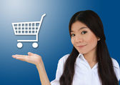 Business woman and cart symbol — Stock Photo